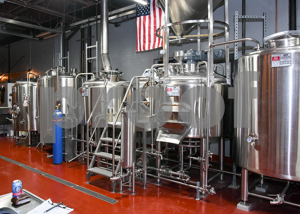 062317 Wesley Bunnell | Staff Alvarium Beer Company held a ribbon cutting on Friday and became the first brewery open in New Britain since the mid 1950's. Steel tanks used in the brewing process line one wall.