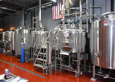 062317  Wesley Bunnell   Staff  Alvarium Beer Company held a ribbon cutting on Friday and became the first brewery open in New Britain since the mid 1950's. Steel tanks used in the brewing process line one wall.