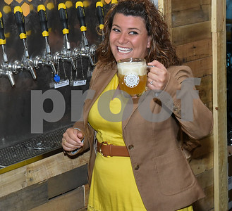 062317  Wesley Bunnell   Staff  Alvarium Beer Company held a ribbon cutting on Friday and became the first brewery open in New Britain since the mid 1950's. Mayor Erin Stewart laughs as she finishes pouring a beer from of the taps lining the wall.
