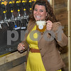 062317  Wesley Bunnell | Staff<br /> <br /> Alvarium Beer Company held a ribbon cutting on Friday and became the first brewery open in New Britain since the mid 1950's. Mayor Erin Stewart laughs as she finishes pouring a beer from of the taps lining the wall.