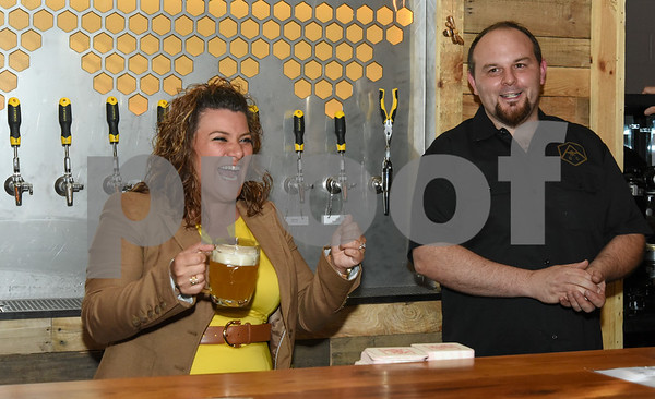 062317 Wesley Bunnell | Staff Alvarium Beer Company held a ribbon cutting on Friday and became the first brewery open in New Britain since the mid 1950's. Mayor Erin Stewart laughs along with Alvarium co-founder Mike Larson.