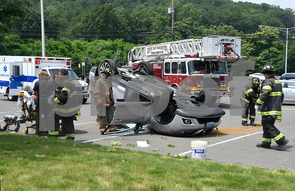 6/23/2017 Mike Orazzi | Staff The scene of a single car rollover crash in the Lake Avenue commuter lot in Bristol Friday afternoon. Firefighters extricated the driver with minor injuries.