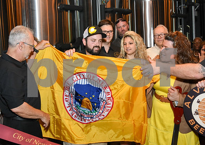 062317  Wesley Bunnell   Staff  Alvarium Beer Company held a ribbon cutting on Friday and became the first brewery open in New Britain since the mid 1950's. Economic Development Director Bill Carrol, L, helps hold a City of New Britain flag along with Alvarium Beer co-founder Chris DeGasero, co-founder Brian Bugnacki, and Mayor Erin Stewart , right.