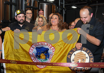 062317  Wesley Bunnell   Staff  Alvarium Beer Company held a ribbon cutting on Friday and became the first brewery open in New Britain since the mid 1950's. Holding a City of New Britain flag is Alvarium Beer co-founder Chris DeGasero, co-founder Brian Bugnacki, Mayor Erin Stewart  co-founder Mike Larson.