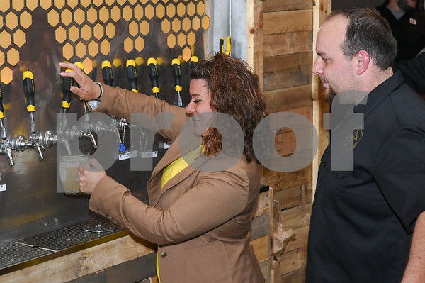 062317 Wesley Bunnell | Staff Alvarium Beer Company held a ribbon cutting on Friday and became the first brewery open in New Britain since the mid 1950's. Mayor Erin Stewart operating one of the several beer taps as Alvarium co-founder Mike Larson looks on.