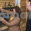 062317  Wesley Bunnell | Staff<br /> <br /> Alvarium Beer Company held a ribbon cutting on Friday and became the first brewery open in New Britain since the mid 1950's. Mayor Erin Stewart operating one of the several beer taps as Alvarium co-founder Mike Larson looks on.