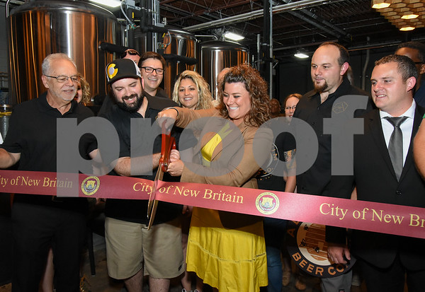 062317 Wesley Bunnell | Staff Alvarium Beer Company held a ribbon cutting on Friday and became the first brewery open in New Britain since the mid 1950's. Among those present at the ribbon cutting were Economic Development Director Bill Carrol, L, Alvarium Beer co-founder Chris DeGasero, co-founder Brian Bugnacki, Mayor Erin Stewart & co-founder Mike Larson.