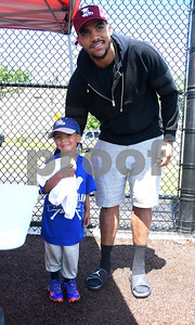 6/24/2017 Mike Orazzi | Staff Washington Redskins tight end Jordan Reed poses with young fan Brandon Santiago during the Tebucky Jones football camp held at Chesley Park in New Britain Saturday.