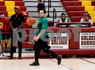 6/24/2017 Mike Orazzi | Staff Alcides Ortiz (1) looks down court during the Mark Carr Scholarship Foundation basketball tournament held at New Britain High School pitting area fire and police departments against each other for a good cause Saturday in New Britain.