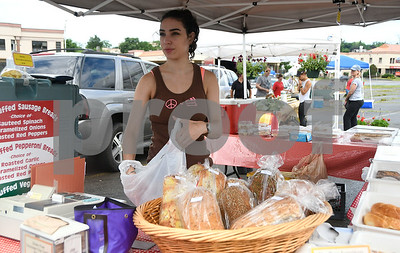6/24/2017 Mike Orazzi | Staff Felice Magistrali bags fresh baked items for a customer at the Better Baking by Beth stand during the Bristol Farmers' Market in Centre Square in downtown Bristol Saturday morning.