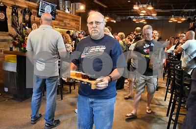 6/24/2017 Mike Orazzi | Staff Phil Hanson carries beer samples during the opening of the Alvarium Beer Company on John Downey Drive in New Britain Saturday.