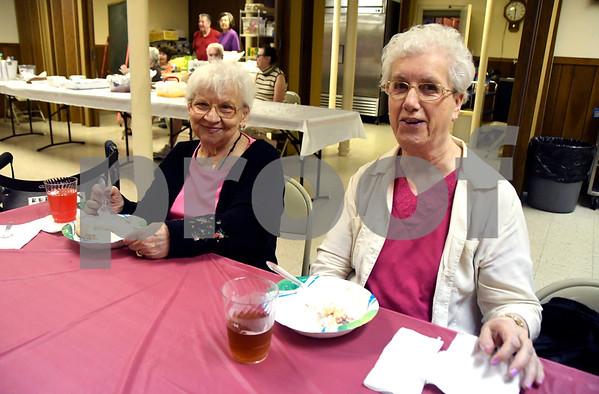 6/24/2017 Mike Orazzi | Staff Irene Zajechowski and Elaine Kondracki enjoy strawberry short cake while at St. Peter Parish in New Britain Saturday.