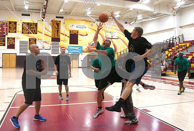 6/24/2017 Mike Orazzi | Staff Steve Ciacia (7) drives to the hoop during the Mark Carr Scholarship Foundation basketball tournament held at New Britain High School pitting area fire and police departments against each other for a good cause Saturday in New Britain.