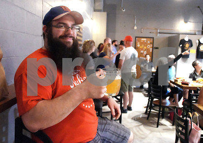 6/24/2017 Mike Orazzi | Staff Rob Rys enjoys an IPA during the opening of the Alvarium Beer Company on John Downey Drive in New Britain Saturday.