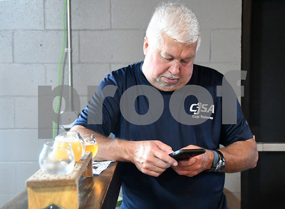6/24/2017 Mike Orazzi | Staff Dean Myshrall rates beer samples during the opening of the Alvarium Beer Company on John Downey Drive in New Britain Saturday.