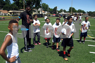 6/24/2017 Mike Orazzi | Staff Tebucky Jones works with players during a football camp held at Chesley Park in New Britain Saturday.