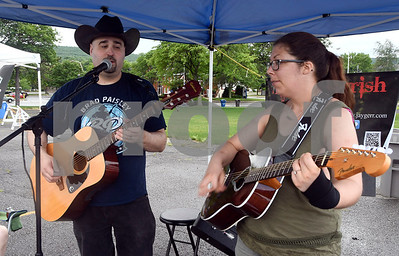 6/24/2017 Mike Orazzi | Staff Jason Gerrish and Jenna Gerrish perform during the Bristol Farmers' Market in Centre Square in downtown Bristol Saturday morning.