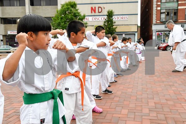 062917 Wesley Bunnell | Staff New Britain Judo and Karate School held an outdoor class in Central park on Thursday evening. Steven Guerrero, stands in line with fellow students as they listen to instruction from Carl Messina, R.