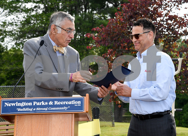 062917 Wesley Bunnell | Staff Newington Mayor Roy Zartarian presents Saputo plant manager Roque Lopez with a proclamation honoring Saputo's commitment to the Town of Newington. A ribbon cutting for the newly installed Saputo Fitness Center was held immediately following the ceremony.