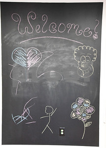 062917  Wesley Bunnell | Staff  A welcome sign inside the front entrance of DribbleBabies Children's Clothing Store in New Britain.
