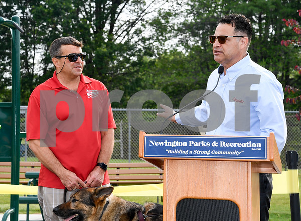 062917 Wesley Bunnell | Staff Newington Parks and Recreation Superintendent Bill DeMaio , L, stands next to Saputo plant manager Roque Lopez as he gives his remarks prior to the ribbon cutting for the Saputo Fitness Center located near the town pool in Mill Pond Park.