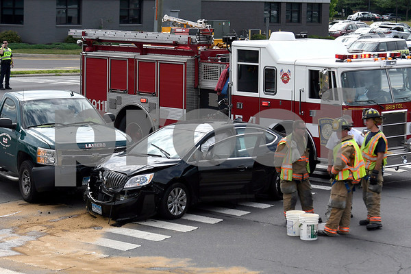 6/29/2017 Mike Orazzi | Staff The scene of a two crash crash at the intersection of Pine and Middle Streets in Bristol Thursday morning. The driver was transported to Bristol Hospital with non-life threatening injuries.