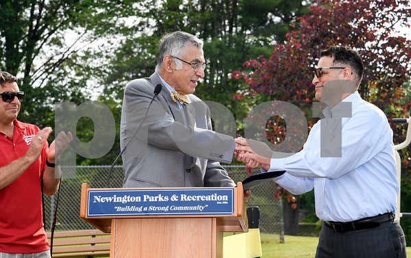 062917 Wesley Bunnell | Staff Newington Parks and Recreation Superintendent Bill DeMaio , L, stands next to Mayor Roy Zartarian as he shakes hands with Saputo plant manager Roque Lopez just after Zartarian read a proclamation honoring Saputo's commitment to the Town of Newington. A ribbon cutting for the newly installed Saputo Fitness Center was held immediately following the ceremony.