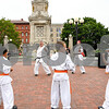 062917  Wesley Bunnell | Staff<br /> <br /> New Britain Judo and Karate School held an outdoor class in Central park on Thursday evening. City Hall can be seen in the background as Ethan Canales, L, Jacob Prokop and Isaac Dabkowski follow instructor Carl Messina, center.