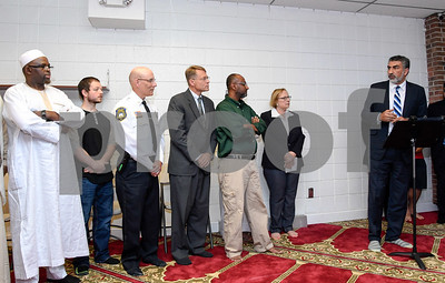 063017  Wesley Bunnell | Staff  Area Muslim leaders and local officials held a press conference Friday at noon in solidarity after a possible hate crime occurred on Arch St in New Britain this past Wednesday.  Police Chief James Wardwell, third from L, Board of Education member Merrill Gay, Omer Abdelgader who was the target of the possible hate crime, State Senator Terry Gerratana listen as Executive Director of the Council on American-Islamic Relations Mongi Dhaouadi speaks.
