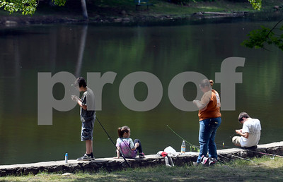 6/30/2017 Mike Orazzi | Staff Cindi Ward while fishing with her children Kaelyn and Logan along with family friend Andrew Pellerin  (right) at Page Park in Bristol Friday afternoon.