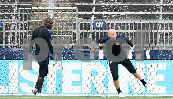 063017 Wesley Bunnell | Staff The United States men's national soccer team practicing on Friday evening in preparation for their Saturday friendly match against Ghana at Rentschler Field in East Hartford. Goalkeeper Bill Hamid, L, practices with fellow goalkeeper Brad Guzan.