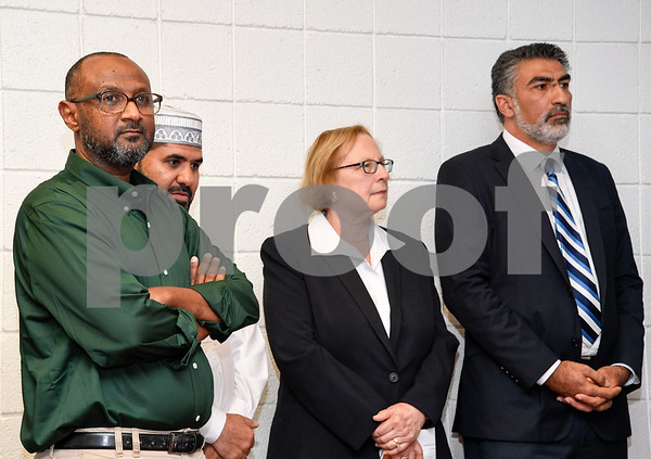 063017 Wesley Bunnell | Staff Area Muslim leaders and local officials held a press conference Friday at noon in solidarity after a possible hate crime occurred on Arch St in New Britain this past Wednesday. Omer Abdelgader, L, who was the target of the possible hate crime, Imam Ibrahaim Alsuraimi, State Senator Terry Gerratana stand next to Executive Director of the Council on American-Islamic Relations Mongi Dhaouadi speaks.