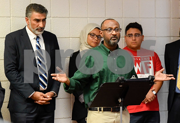 063017 Wesley Bunnell | Staff Area Muslim leaders and local officials held a press conference Friday at noon in solidarity after a possible hate crime occurred on Arch St in New Britain this past Wednesday. President of the Islamic Center of Central CT and victim of the possible hate crime Omer Abdelgader at the podium. To the left is Executive Director of the Council on American-Islamic Relations Mongi Dhaouadi.