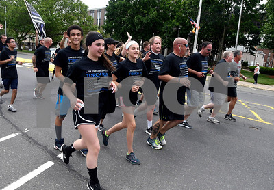 6/8/2017 Mike Orazzi | Staff The Special Olympics Torch Run on North Main Street in Bristol Thursday.