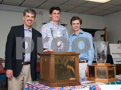 060817 Wesley Bunnell   Staff  The New Britain/Berlin Rotary Club held an awards luncheon on Thursday afternoon honoring high school golfers from both boys and girls teams from New Britain, Berlin and the boys team from EC Goodwin. The 54th Annual Stan Pisk Memorial High School Golf Championship was previously held on Tuesday May 30. Berlin boys coach John Line poses with the championship trophy and two of the players.