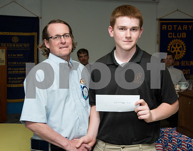 060817 Wesley Bunnell | Staff  The New Britain/Berlin Rotary Club held an awards luncheon on Thursday afternoon honoring high school golfers from both boys and girls teams from New Britain, Berlin and the boys team from EC Goodwin. The 54th Annual Stan Pisk Memorial High School Golf Championship was previously held on Tuesday May 30. EC Goodwin's Josh Donaghy poses with Rotary President Kenneth Jones as he receives his scholarship.
