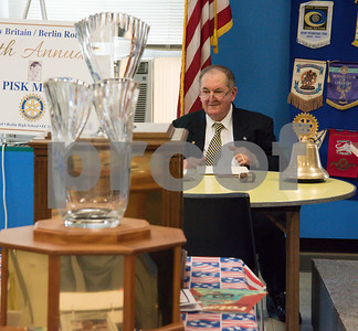060817 Wesley Bunnell   Staff  The New Britain/Berlin Rotary Club held an awards luncheon on Thursday afternoon honoring high school golfers from both boys and girls teams from New Britain, Berlin and the boys team from EC Goodwin. The 54th Annual Stan Pisk Memorial High School Golf Championship was previously held on Tuesday May 30. Ted Pisk, son of the late Stan Pisk, sits at the end of the ceremony with the boys and girls championship trophies on the table.