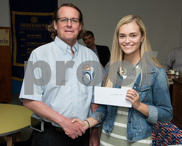 060817 Wesley Bunnell   Staff  The New Britain/Berlin Rotary Club held an awards luncheon on Thursday afternoon honoring high school golfers from both boys and girls teams from New Britain, Berlin and the boys team from EC Goodwin. The 54th Annual Stan Pisk Memorial High School Golf Championship was previously held on Tuesday May 30. New Britain High School's Ava Morrell poses with Rotary President Kenneth Jones as she receives her scholarship.