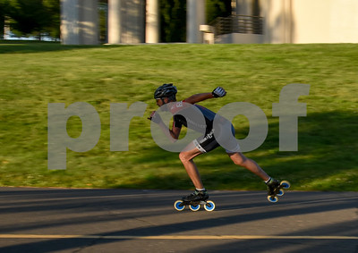 060717 Wesley Bunnell | Staff  An inline skater heads through a very busy Walnut Hill Park on Wednesday afternoon in the early evening light.