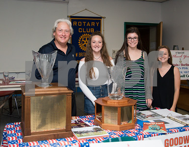 060817 Wesley Bunnell | Staff  The New Britain/Berlin Rotary Club held an awards luncheon on Thursday afternoon honoring high school golfers from both boys and girls teams from New Britain, Berlin and the boys team from EC Goodwin. The 54th Annual Stan Pisk Memorial High School Golf Championship was previously held on Tuesday May 30. Berlin girls head coach Jim Barnes poses with three members of the team and their championship trophy.