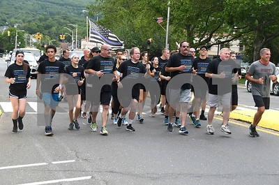 6/8/2017 Mike Orazzi   Staff The Special Olympics Torch Run on North Main Street in Bristol Thursday.