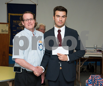 060817 Wesley Bunnell   Staff  The New Britain/Berlin Rotary Club held an awards luncheon on Thursday afternoon honoring high school golfers from both boys and girls teams from New Britain, Berlin and the boys team from EC Goodwin. The 54th Annual Stan Pisk Memorial High School Golf Championship was previously held on Tuesday May 30. New Britain High School's Kevin Merkle poses with Rotary President Kenneth Jones as he receives his scholarship.
