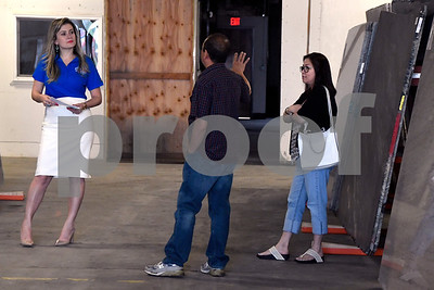 6/3/2017 Mike Orazzi | Staff Stone Vally Granite and Marble's Ellisa Xavier talks with customers Manny and Joy DeCastro about granite options during their grand opening on Wooster Street in New Britain Saturday morning.