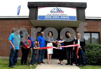 6/3/2017 Mike Orazzi | Staff New Britain Mayor Erin Stewart and Stone Vally Granite and Marble's Ellisa Xavier cut the ribbon during their grand opening on Wooster Street in New Britain Saturday morning.