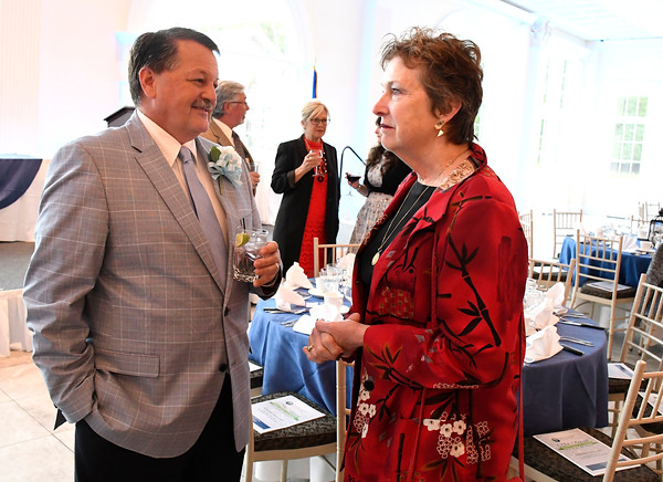 6/6/2018 Mike Orazzi | Staff E. Bartlett Barnes Distinguished Service award winner Tim Furey talks with Dr. Vicky Biondi during the 129th Annual Bristol Chamber of Commerce Awards Dinner held at the Aqua Turf Club in Southington Wednesday night.