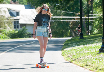06/12/18  Wesley Bunnell | Staff  Abi Baker of New Britain rides her long board through several laps of Walnut Hill Park on Tuesday afternoon.