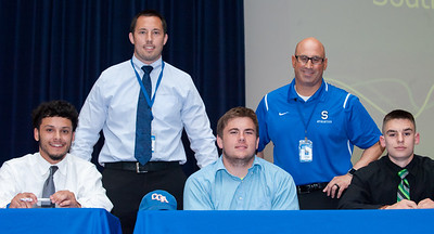 06/12/18  Wesley Bunnell | Staff  Southington High School football players Ryan Montalvo, L, Jake Monson and James Ringrose signed their college commitment letters on Tuesday afternoon. Head coach Mike Drury, L, and Athletic Director Greg Ferry.