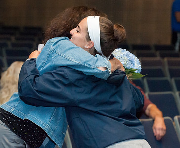 06/12/18  Wesley Bunnell | Staff  Dawn Ferrante hugs her daughter Frankie and presented her with flowers after signing her commitment to play college softball. Southington High School held college signings on Tuesday afternoon for 15 student athletes committed to playing college sports.