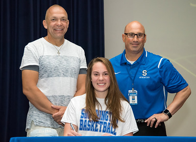 06/12/18  Wesley Bunnell | Staff  Southington High School basketball player Janette Wadolowski signed her college commitment letter on Tuesday afternoon. Head coach Mike Forgione, L, and Athletic Director Greg Ferry.