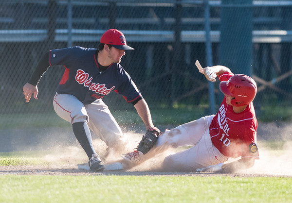 06/25/18 Wesley Bunnell | Staff Bristol Legion baseball vs Winsted on Monday evening at Muzzy Field. Third baseman MacGregor Goulet (10) is thrown out on an attempted steal of third.